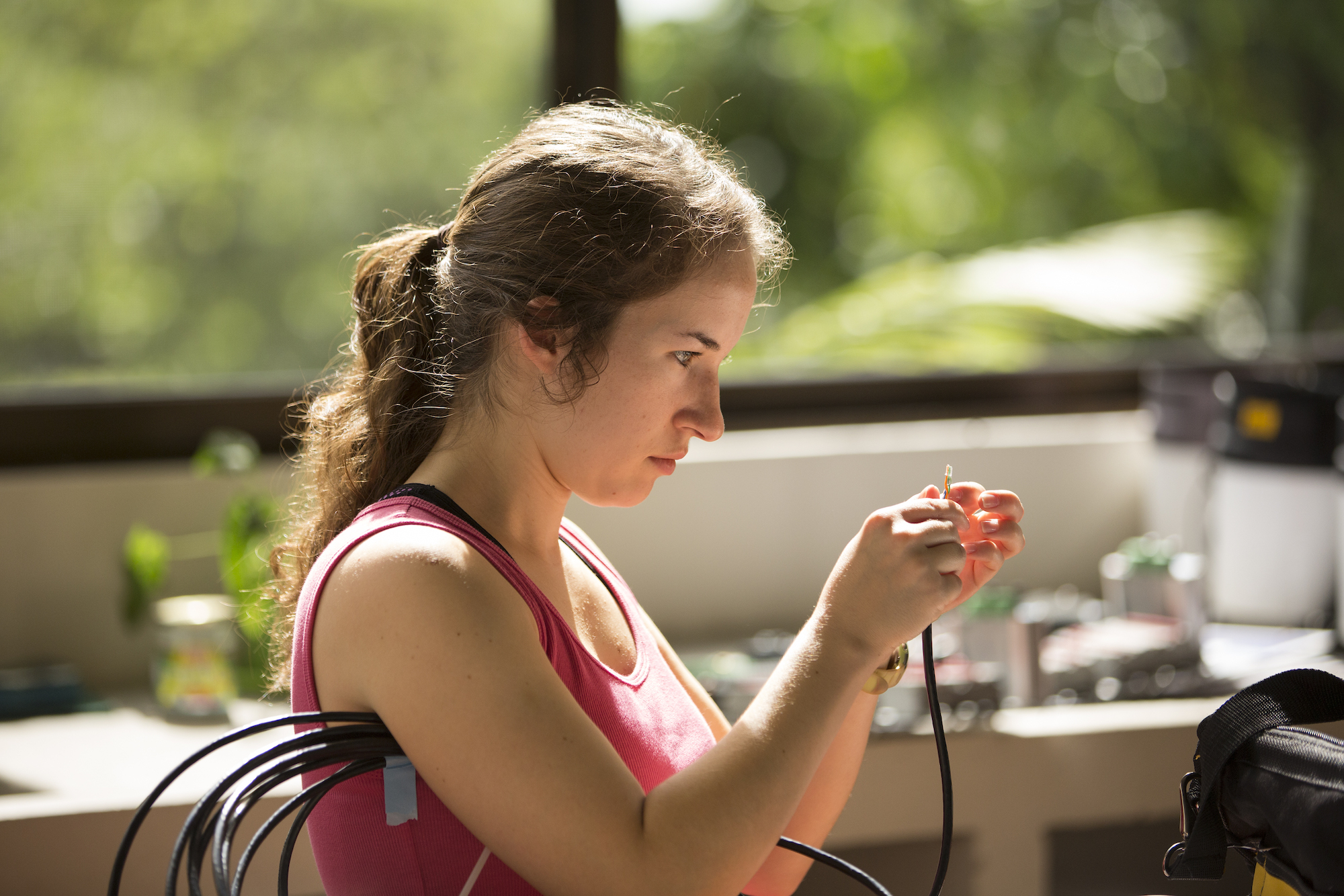 Student examining equipment wires